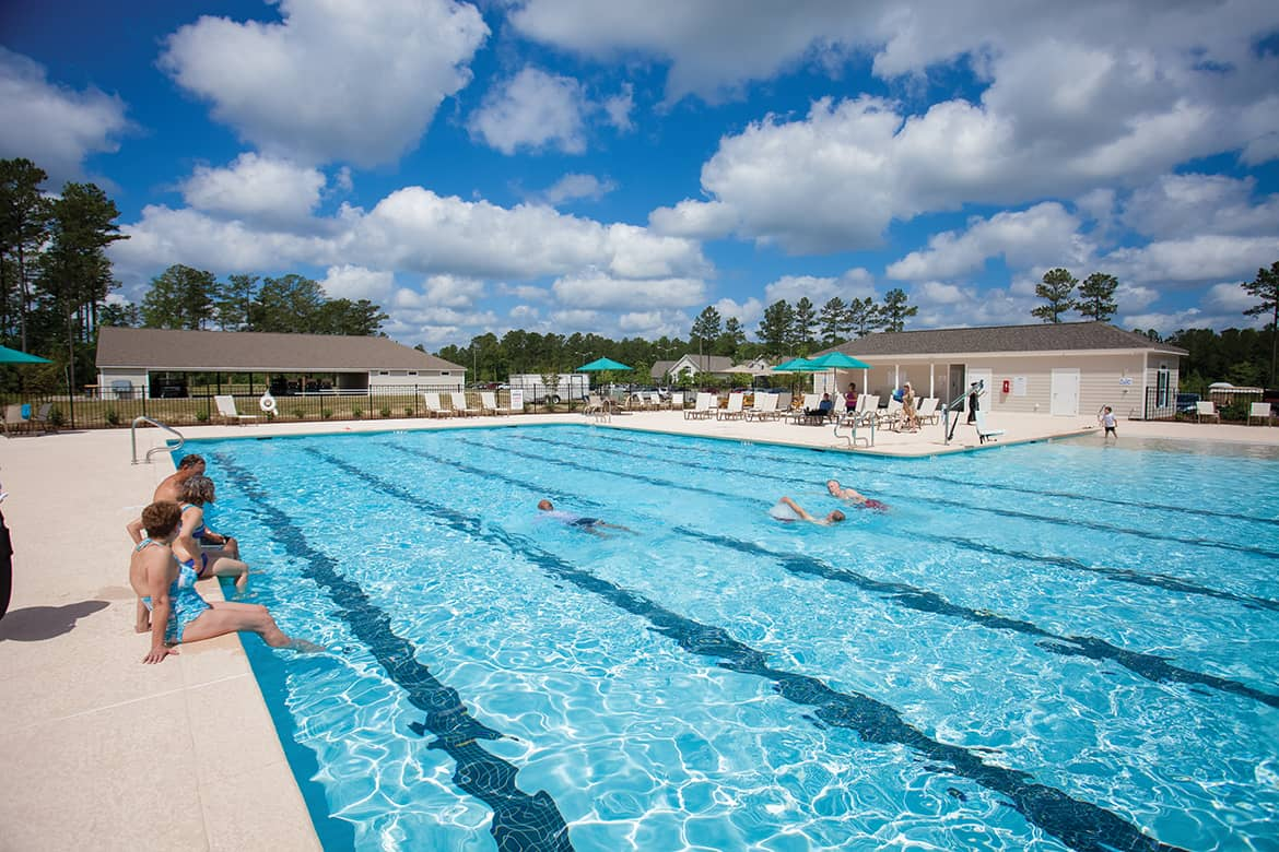 Carolina Colours residents poolside at private retirement community pool