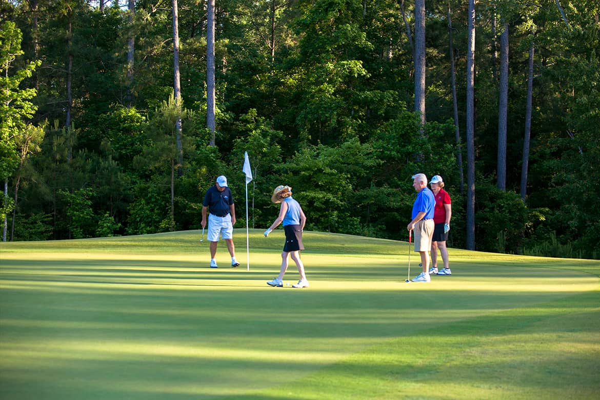Two retired couples playing a round of golf at Carolina Colours premier community golf course